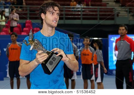 KUALA LUMPUR - SEPTEMBER 29: Winner Joao Souso (Portugal) lifts the singles champion trophy of the Malaysian Open 2013 in Putra Stadium, Malaysia on September 29, 2013. He defeated Julien Benneteau.