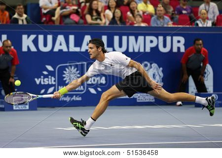 KUALA LUMPUR - SEPTEMBER 29:Joao Souso (Portugal) hits a return in the singles final of the Malaysian Open 2013 in Putra Stadium, Malaysia on September 29, 2013. He defeated Julien Benneteau (France).