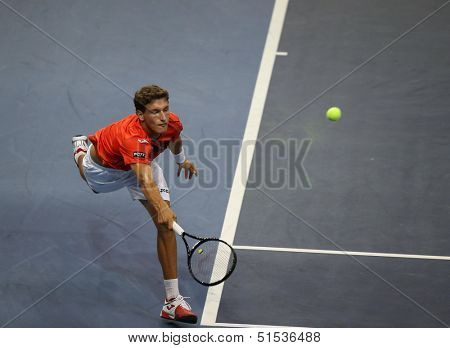 KUALA LUMPUR - SEPTEMBER 24: Pablo Carreno Busta (Spain) hits a return in a first round tennis match at the Malaysian Open 2013 played at the Putra Stadium, Malaysia on September 24, 2013.
