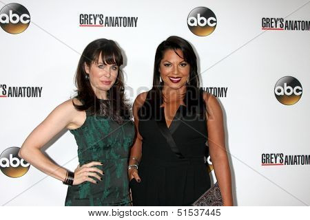 LOS ANGELES - SEP 28:  Danielle Bisutti, Sara Ramirez at the Grey's Anatomy 200th Show Party at The Colony on September 28, 2013 in Los Angeles, CA