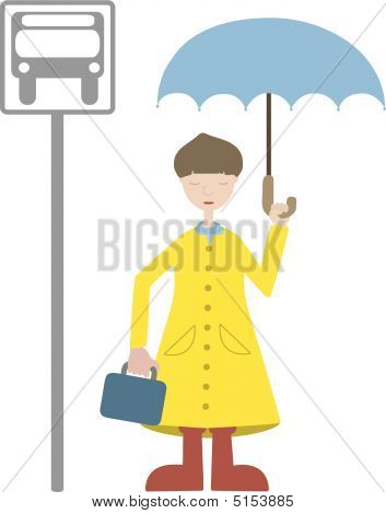 Young Man Waiting For Transport In Rain Coat