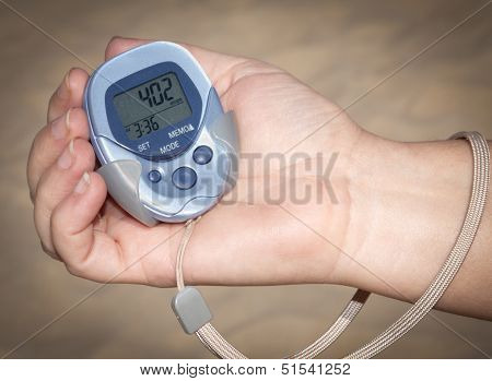 Woman Holding Pedometer