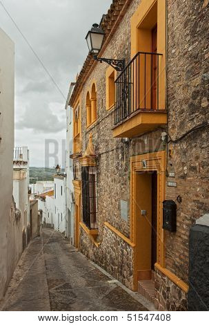 The narrow street with old houses, Arcos de la Frontera, Andalusia, Spain.