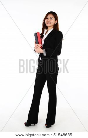 Portrait Of A Young Business Woman Holding Files With A Smile, On A White Background