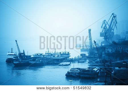 Crane And Cargo Ship At Inland Port