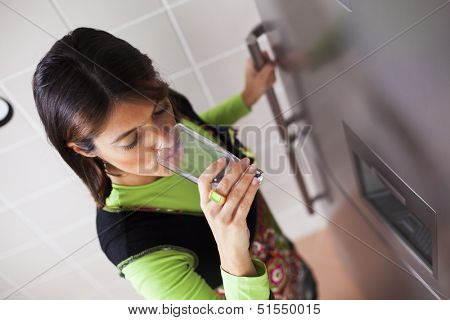 woman taking some water from her refrigerator