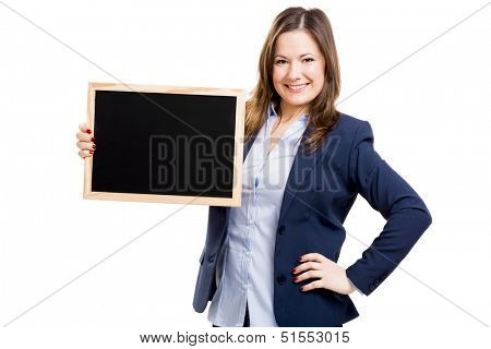 Business woman holding a shalkboard, isolated over a white background