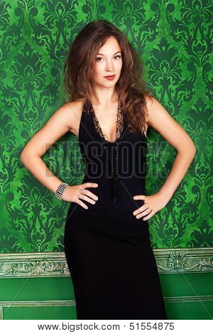 Beautiful Brunette Model Against A Green Vintage Wall Fashion Glamour Style