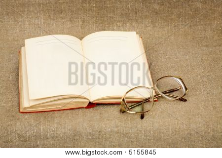 Ancient Book And Spectacles