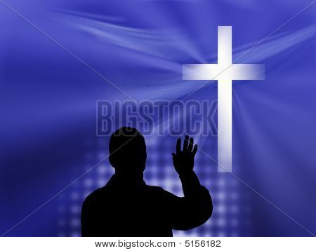 Silhouetted Man And Cross on Blue Background