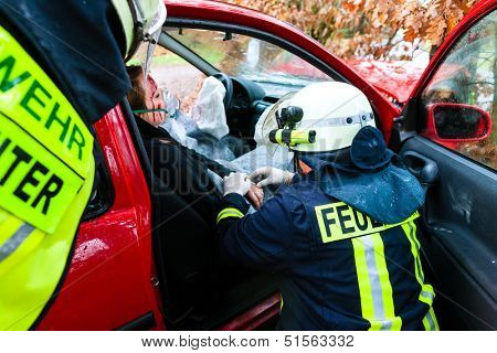 Accident - Fire brigade rescues accident Victim of a car, firefighter gives first aid