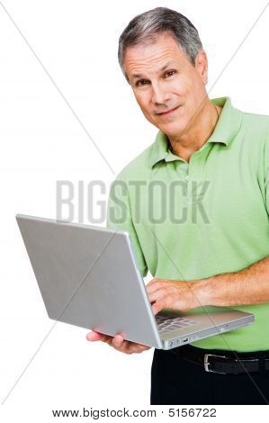 Portrait Of A Man Working On Laptop