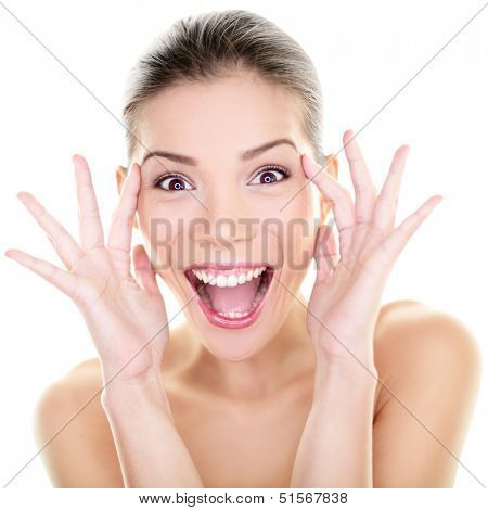 Beauty - happy funny Asian woman face expression. Girl surprised and excited showing fun facial expression. Beautiful healthy girl with perfect skin screaming joyful in surprise. Asian Caucasian model