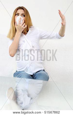 Pregnant woman on the white background .