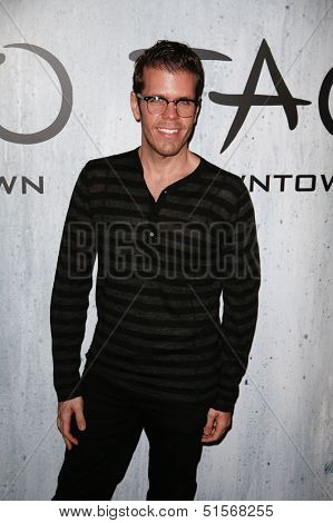 NEW YORK-SEP 28: Blogger Perez Hilton attends the grand opening of TAO Downtown at the Maritime Hotel on September 28, 2013 in New York City.