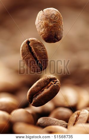 Coffee beans falling into a heap
