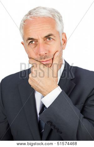 Thoughtful mature businessman looking away on white background