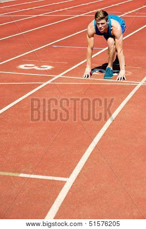 Athletic Man On Track, All Set For Race.