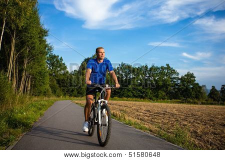 Young man biking