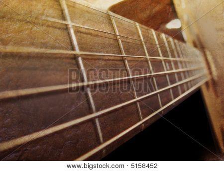 Old Brown Acoustic Guitar Closeup