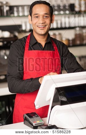 Cheerful Barista Staff At The Cash Counter