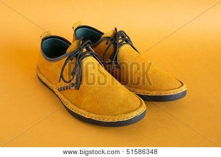 male modern style orange moccasin
