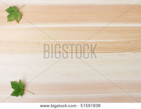 Two Green Sycamore Leaves On A Wood Background