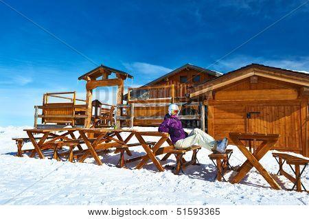 Woman at winter ski resort, Courchevel, Alps, France