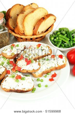 Sandwiches with cottage cheese and greens on plate isolated on white