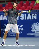 KUALA LUMPUR - SEPTEMBER 27: Adrian Mannarino volleys a return to Julien Benneteau in a semi-final m