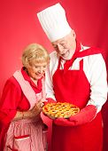 Chef examines a beautiful cherry pie baked by a housewife/student.