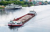 stock photo of barge  - A barge and boat on the river - JPG