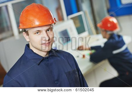 portrait of positive adult industrial worker at factory workshop