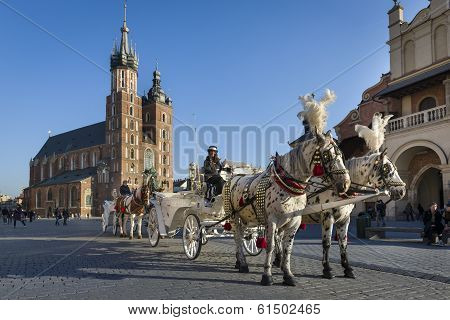 Hansom Cab On Old Town Square In Krakow, Poland.
