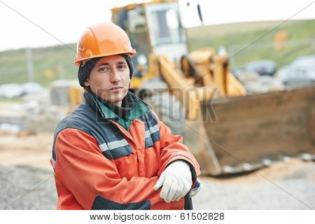 Portrait of young worker builder at construction site