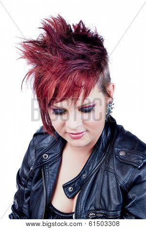 An attractive young female with a punk red hair hairstyle