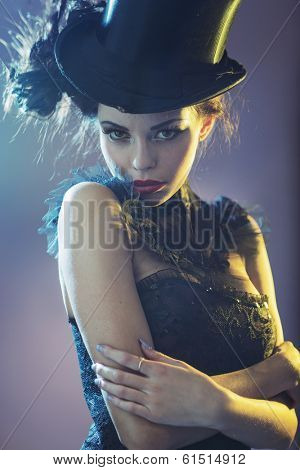 Portrait of a attractive young female model with a top hat