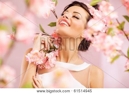 Beautiful smiling woman with spring flowers