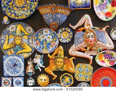 The Trinacria symbol of Sicily and typical Sicilian glazed ceramic