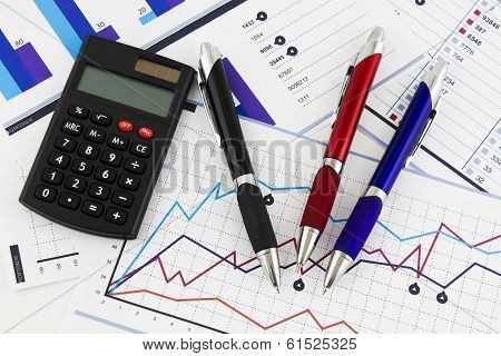 Pens And Calculator On Financial Chart