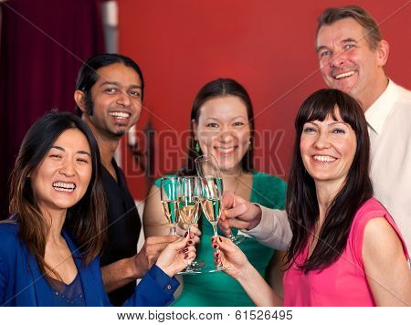 Group Of Multiethnic Friends Celebrating.