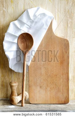 Chef hat and empty cutting board