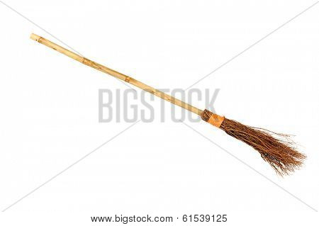 Witch broomstick isolated on white background