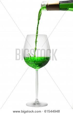 pouring green liquid in a glass