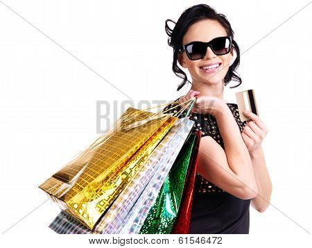 Happy Woman In Glasses With Purchasing.