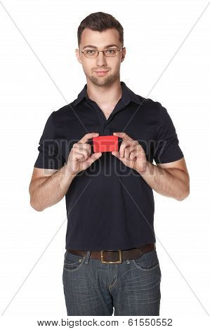 Cheerful male showing red card in hand