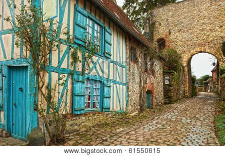 Old street  in medieval village. Gerberoy is a commune in the Oise department in northern France. Focus on window.