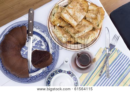 Borek And Chocolate Cake Served At A Party