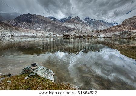 Sacred mountain lake Lohan Tso in Himalayas. Nubra valley, Ladakh, Jammu and Kashmir, India