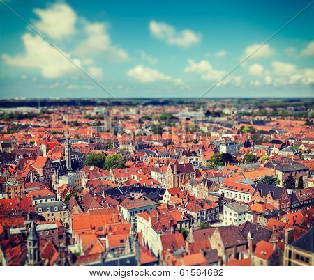 Vintage retro hipster style travel image of aerial view of Bruges (Brugge) from Belfry, Belgium with tilt shift toy effect shallow depth of field